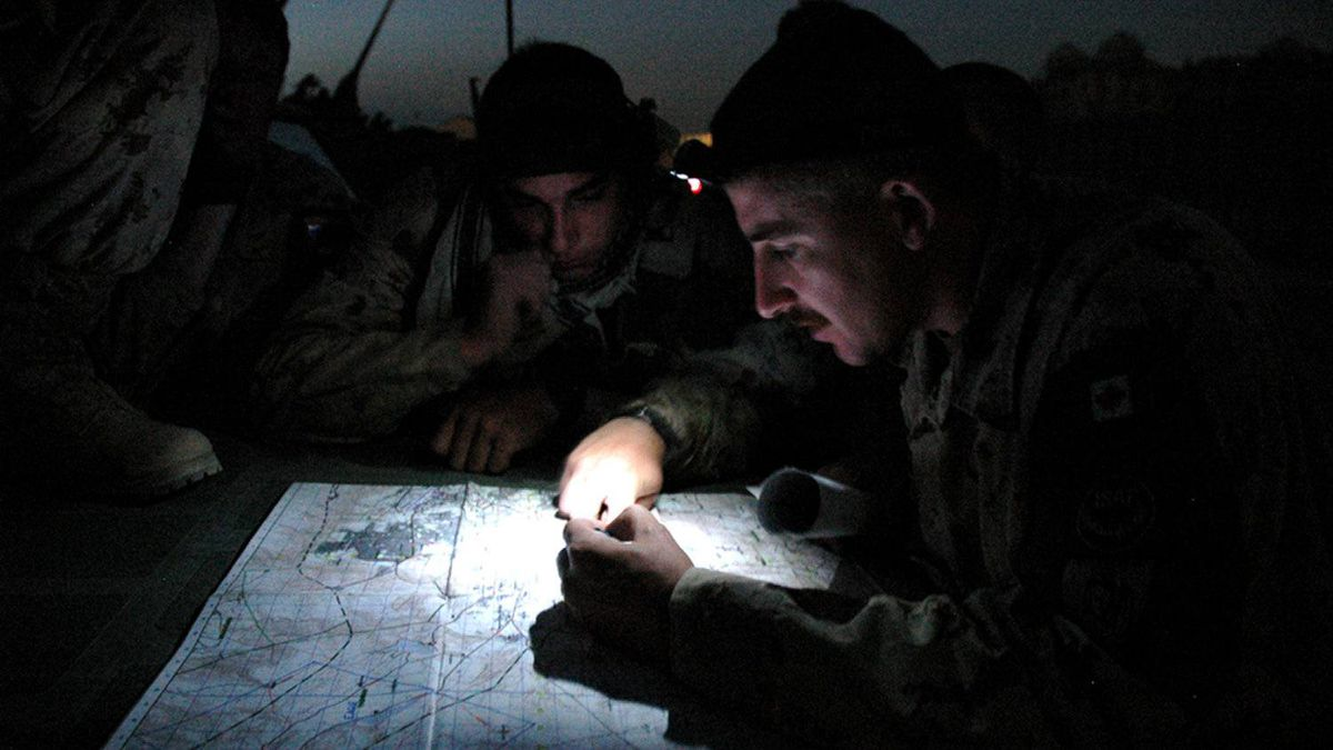 Sgt. Jack Durnford of the Royal Canadian Dragoons prepares his team for a night patrol around Kabul, almost exactly 24 hours before a similar patrol was attacked yesterday with an improvised explosive device. 2005