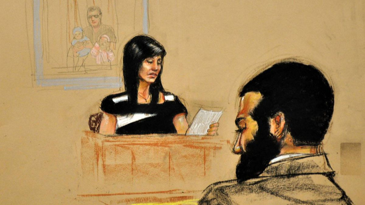 Tabitha Speer, widow of Sergeant Chris Speer, killed by Omar Khadr, reads a letter her children wrote to Mr. Khadr. Speer appeared in court Oct. 28, 2010.