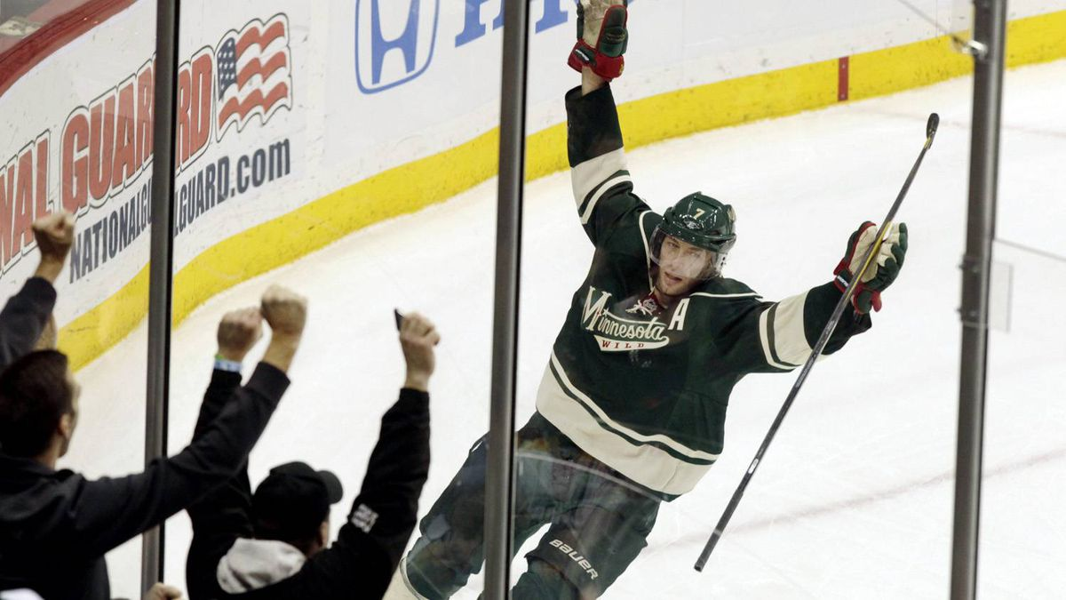 Minnesota Wild centre Matt Cullen (7) celebrates after scoring on Boston Bruins goalie Tim Thomas (30) during the second period of an NHL hockey game, Sunday, Feb. 19, 2012, in St. Paul, Minn. The Wild won 2-0. (AP Photo/Genevieve Ross)