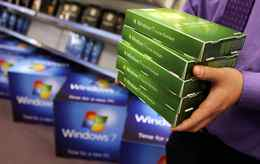 A computer store employee in London, England stacks copies of Microsoft's new operating system ' ahead of its official launch. Microsoft's much-anticipated version of its Windows operating system for PCs aims to eradicate many of the problems associated with its predecessor .