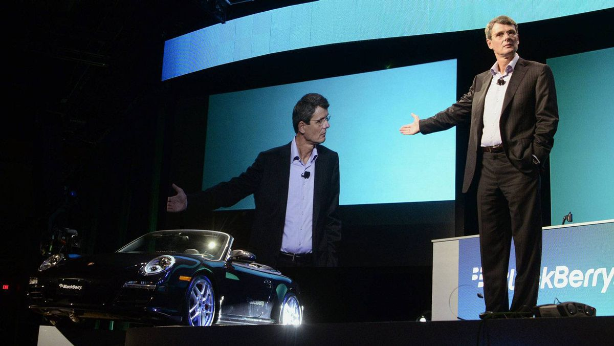 """Research in Motion Chief Executive Officer Thorsten Heins stands with a Porsche that is integrated with a prototype of the BlackBerry 10 smartphone at the BlackBerry World event in Orlando May 1, 2012. very special Porsche Carrera equipped by Canada's QNX (now owned by RIM). You can simply ask the cloud-linked navigation system to find the nearest Timmy's and it will hunt down some choices for you. You can ask the car to phone someone, and it will do so – and the handsfree phone can be made to """"talk"""" only to the driver, to the passenger, or both."""