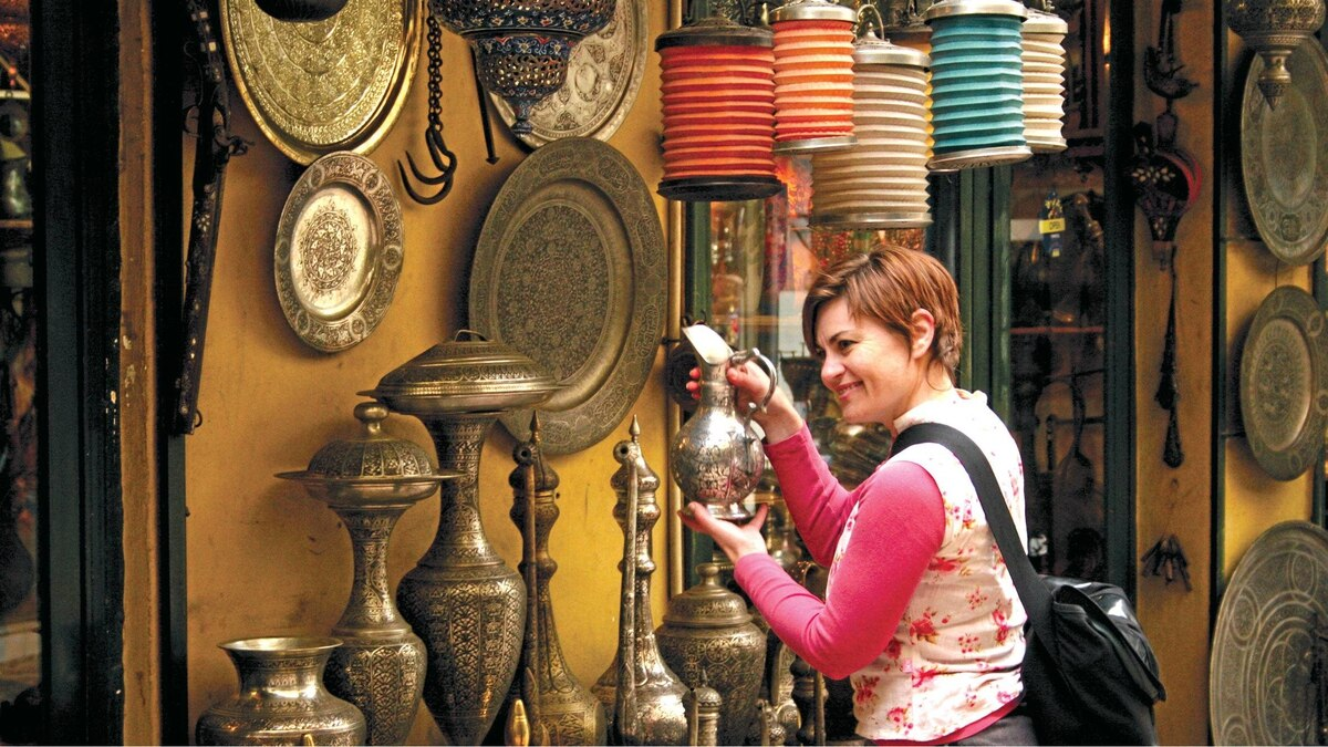 Shop in Istanbul or track gorillas with a tour group if your partner doesn't like to travel.