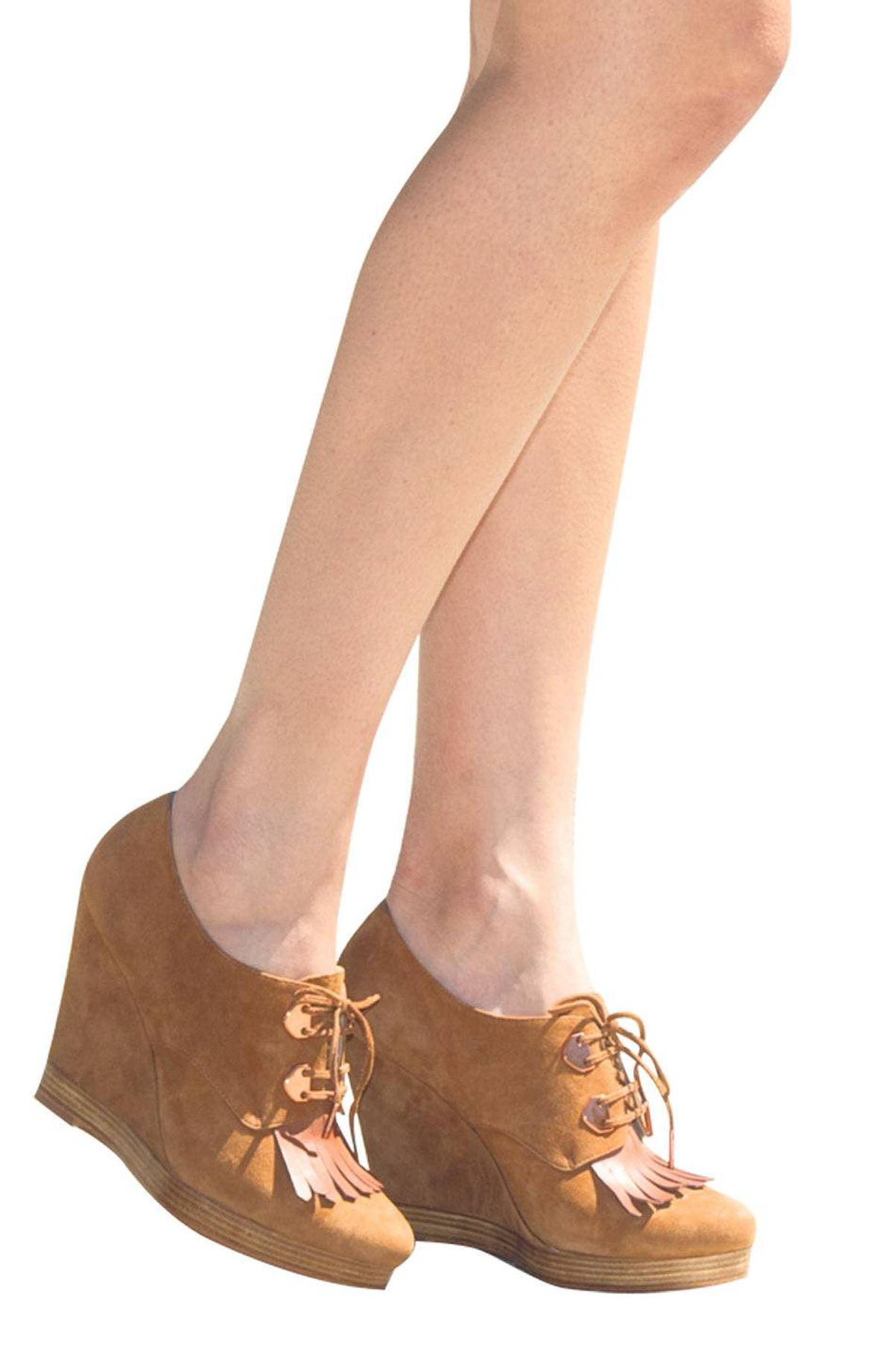 An all-suede wedge with tassel detail makes an updated seventies statement. Kors Michael Kors wedges, $275.