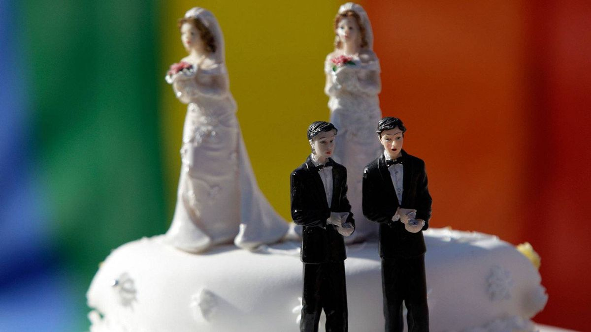 Wedding cake is served by activists outside the Portuguese parliament, Friday, Jan. 8 2010, in Lisbon, after lawmakers passed a bill allowing gay marriage.