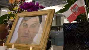 Flowers and pictures are displayed outside the international arrivals area at the Vancouver airport in 2007 in memory of Robert Dziekanski.