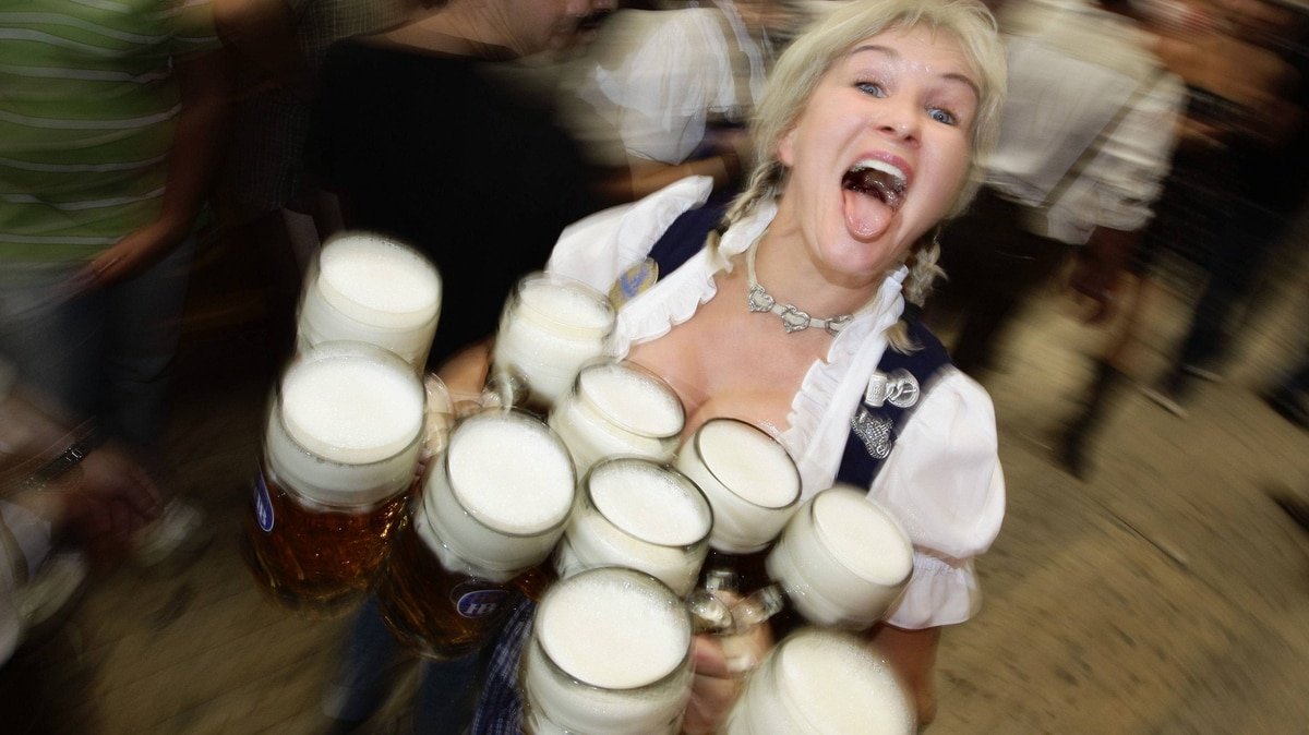 A waitress carries the traditional 1-litre beer mugs at the opening of the world's biggest beer festival, the Munich Oktoberfest, at the Theresienwiese in Munich, September 17, 2011. The world's biggest beer fest runs until October 3.