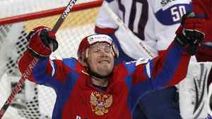 Russia's Alexander Perezhogin (L) celebrates scoring to the Slovakia's goalkeeper Jan Laco net during their 2012 IIHF World Championship final game in Helsinki May 20, 2012.