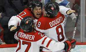 Canada's Sidney Crosby celebrates with teammates Scott Niedermayer, left, and Drew Doughty after scoring the game winning goal against the U.S. during overtime in their men's ice hockey gold medal game at the Vancouver 2010 Winter Olympics February 28, 2010.