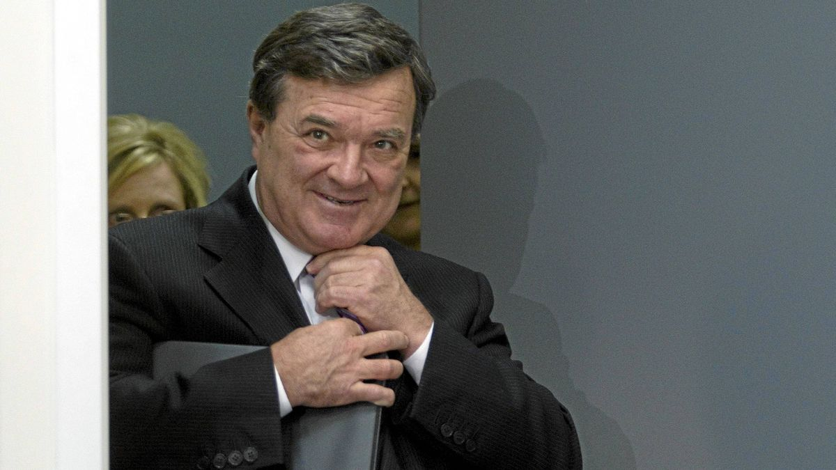 Finance Minister Jim Flaherty adjusts his tie as he arrives at a news conference to announce tax breaks for Canadian caregivers in Toronto on Thursday, Feb. 23, 2012.