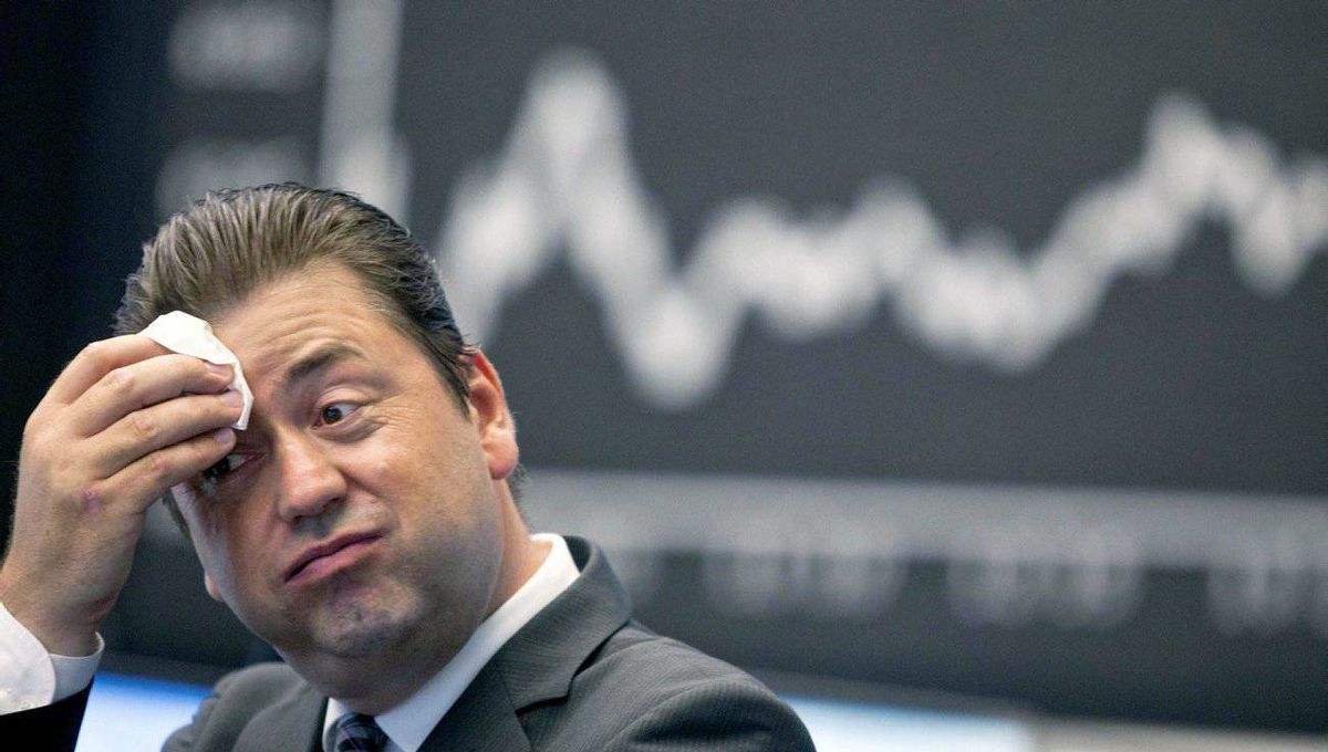 A stock trader reacts to a declining Dax in Frankfurt on Aug. 5, 2011.