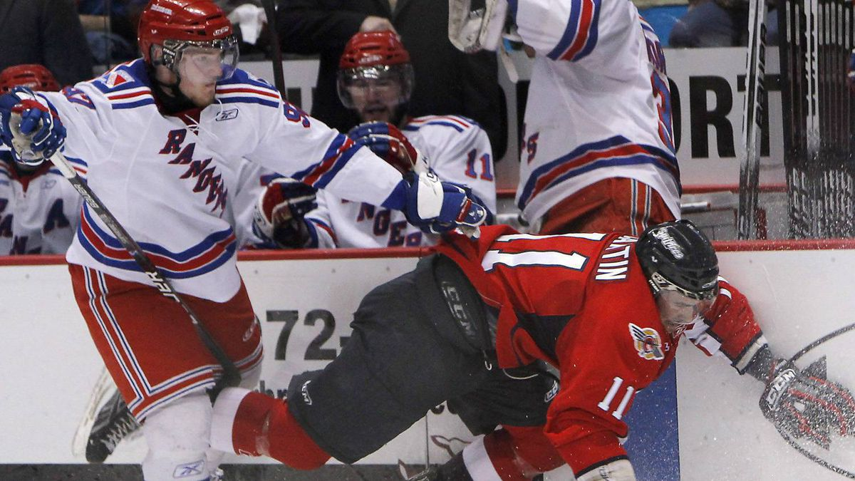 Windsor Spitfires' Marc Cantin, right, collides with Kitchener Rangers' Gabriel Landeskog, left, during OHL hockey playoff action on Sunday, Apr. 25, 2010 in Windsor, Ont. Drummondville Voltigeurs centre Sean Couturier, Kitchener Rangers left-winger Gabriel Landeskog and Red Deer Rebels centre Ryan Nugent-Hopkins are among the top prospects in the NHL Central Scouting Bureau's preliminary rankings for the 2011 draft. THE CANADIAN PRESS/Greg Plante