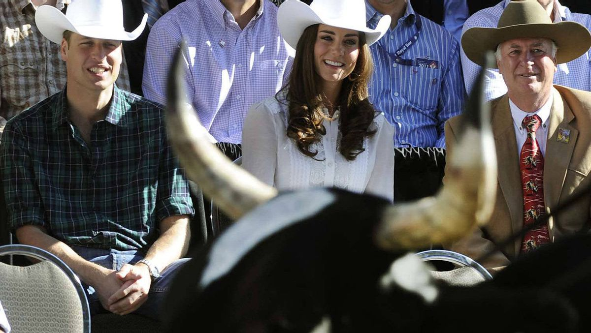 Prince William and Catherine, the Duchess of Cambridge watch the start of the 2011 Calgary Stampede Parade in Calgary, on July 8, 2011.
