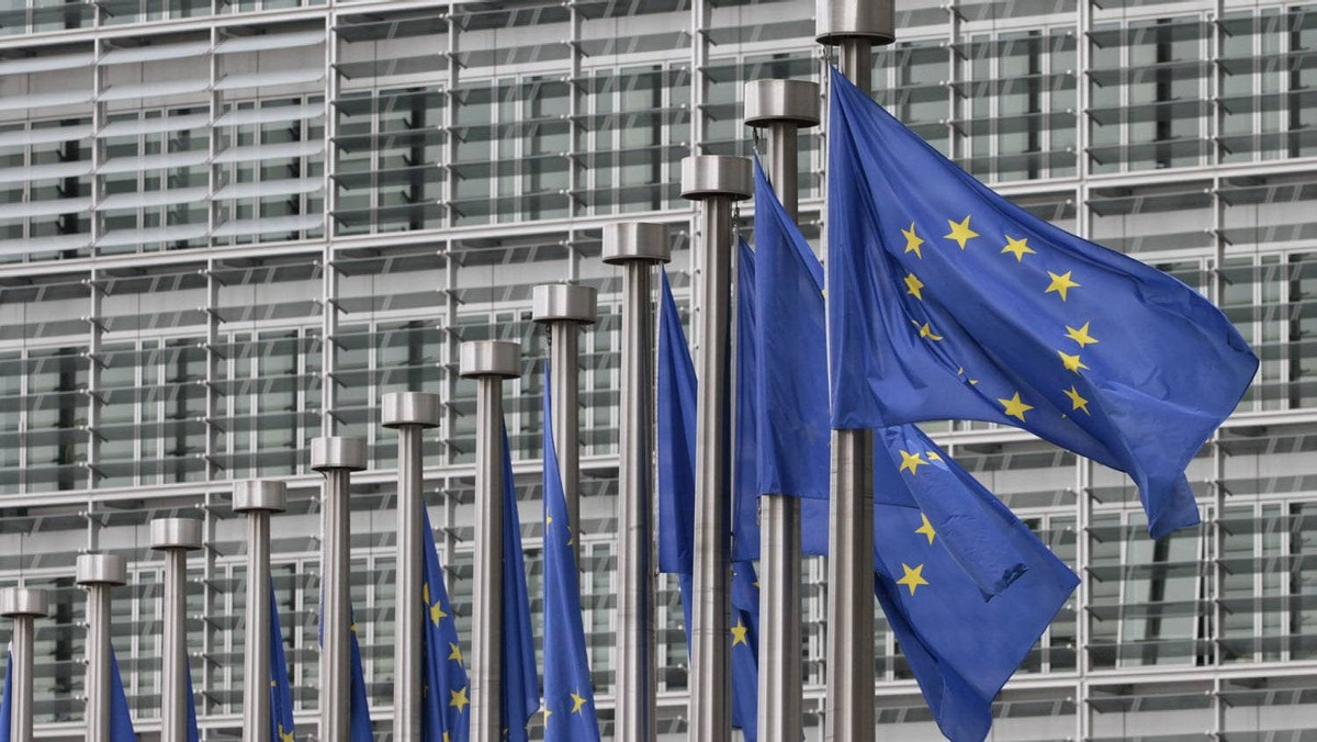 EU flags fly at the European Commission headquarters in Brussels, Monday, May 9, 2011.