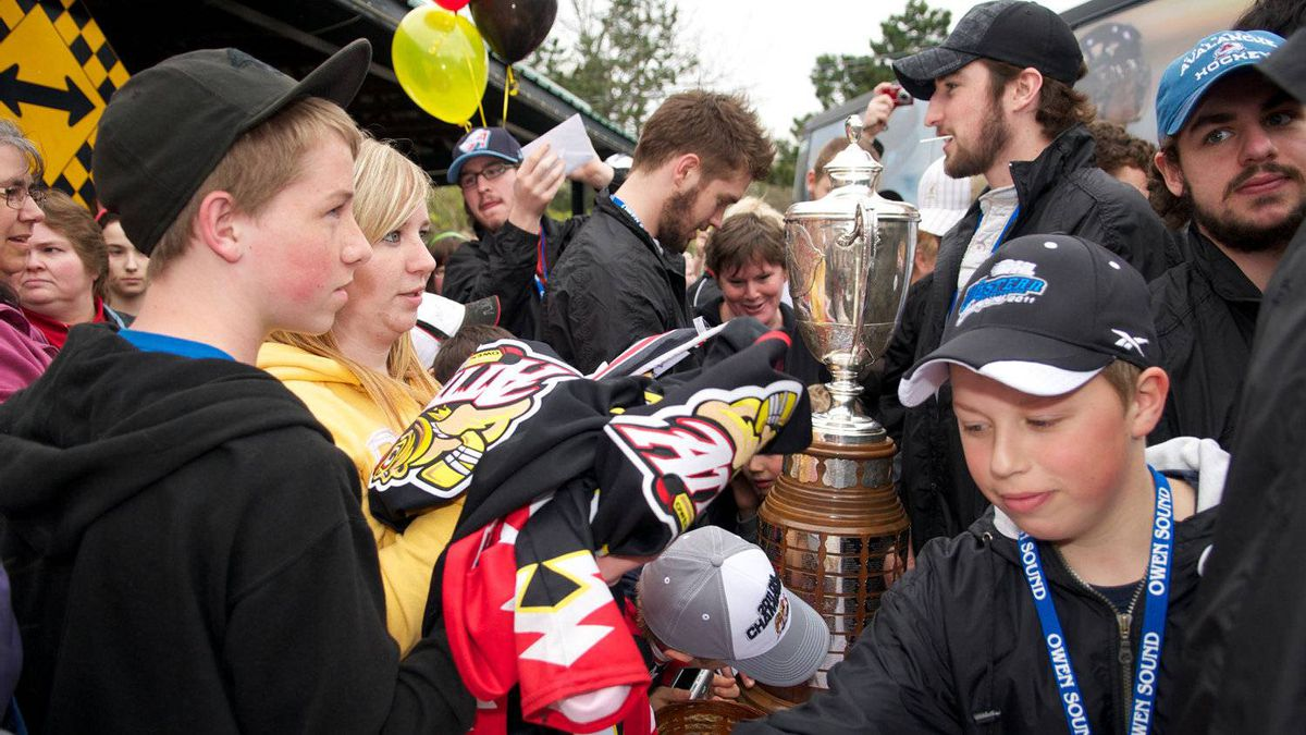 The 2011 OHL Champions Owen Sound Attack celebrate with fans before departing for the Memorial Cup, in Owen Sound, May 18, 2011.