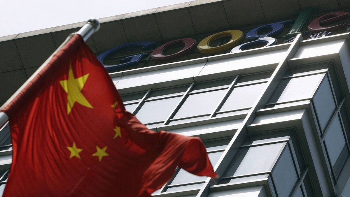 A Chinese national flag waves in front of the former headquarters of Google China in Beijing June 2, 2011