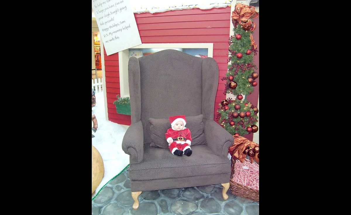 """Monika Czyz writes: """"Isabel's first Christmas: she dressed up as Santa and stole his chair."""""""