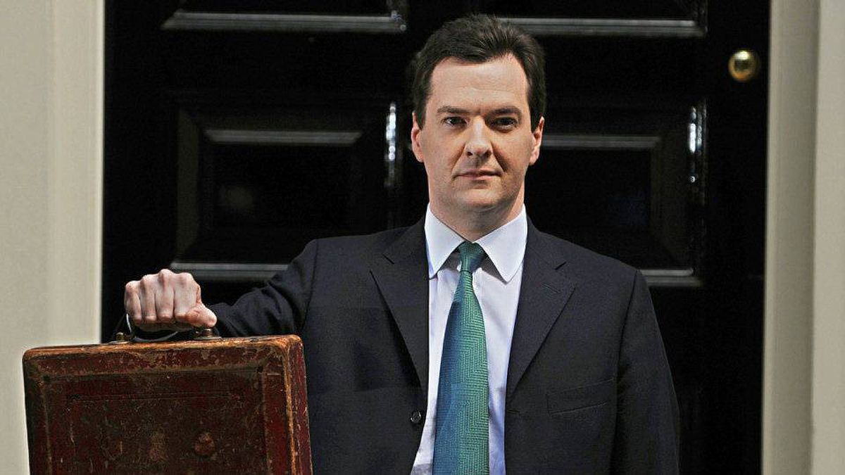 British Chancellor of the Exchequer George Osborne holds Gladstone's red box as he poses for pictures outside 11 Downing Street in London, on June 22, 2010.