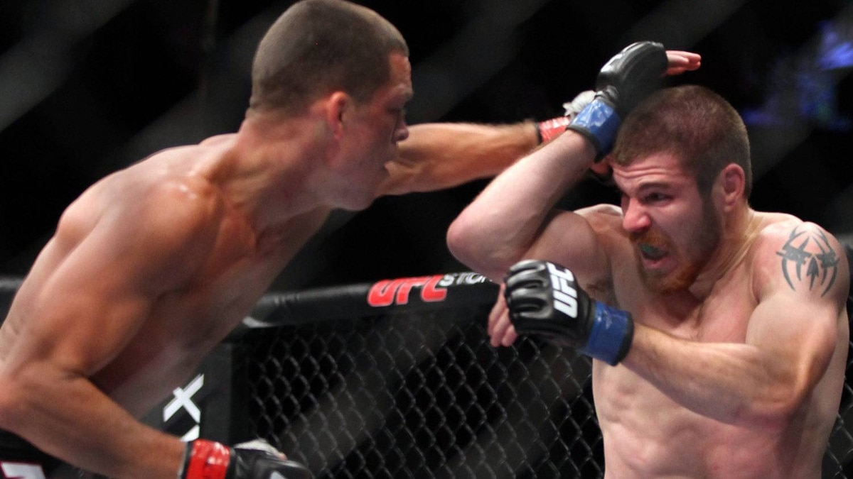 Nate Diaz, left, lands a punch against Jim Miller during their lightweight bout at UFC on Fox at the Izod Center in E. Rutherford, NJ on Saturday, May 5, 2012. Diaz won via tapout due to a choke in round 2. (AP Photo/Gregory Payan)