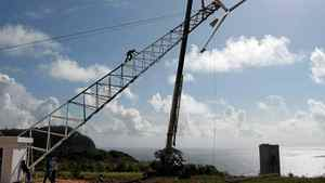Small turbines, like this one in the Dominican Republic, require little maintenance and can be erected by a trailor.