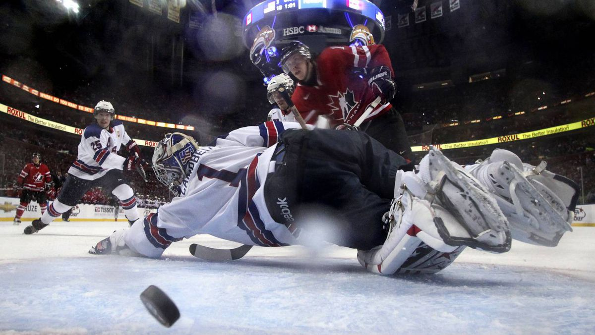 Canada's Ryan Johansen scores on USA's goaltender Jack Campbell in the second period.