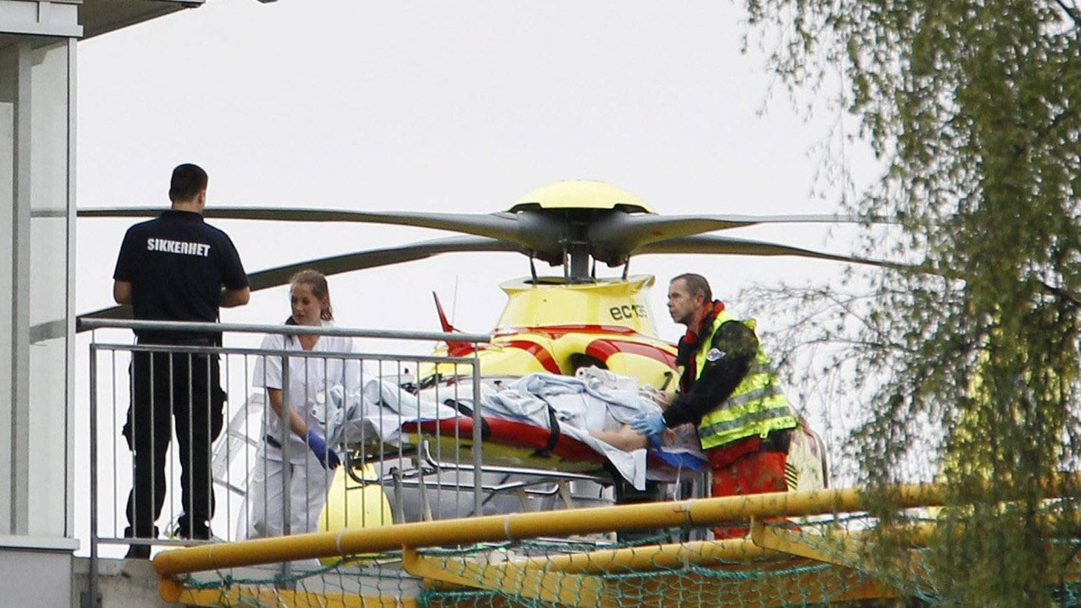 A person injured in the shooting at a youth retreat on the island of Utoya is taken from a helicopter into the Ullevaal Hospital in Oslo on July 22, 2011.