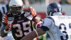 B.C. Lions RB Tim Brown runs the ball against Toronto Argonauts Jeff Johnson during their CFL football game in Vancouver, British Columbia September 10, 2011. REUTERS/Ben Nelms