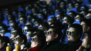 Audience members watch a movie through 3D glasses at a newly opened IMAX theatre on February 8, 2007 in Wuhan of Hubei Province, China.