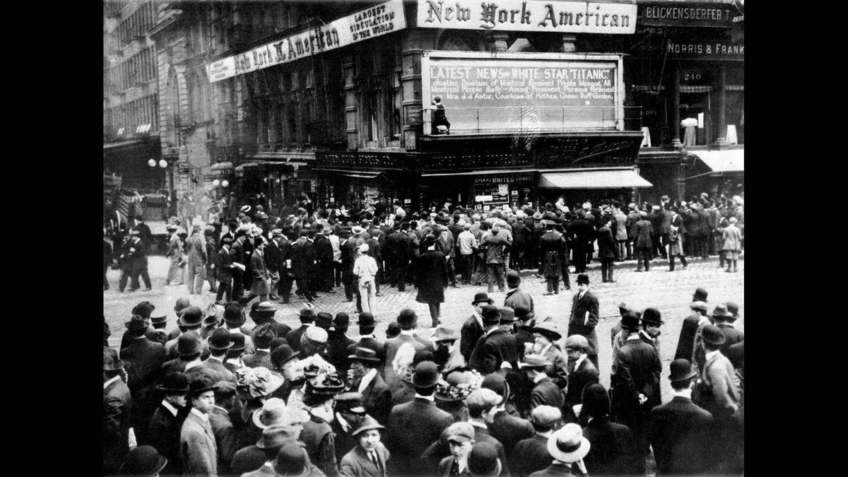 "In this April 1912 file photo, crowds gather around the bulletin board of the New York American newspaper in New York, where the names of people rescued from the sinking Titanic are displayed. It was a news story that would change the news. From the moment that a brief Associated Press dispatch relayed the wireless distress call _ ""Titanic ... reported having struck an iceberg. The steamer said that immediate assistance was required"" _ reporters and editors scrambled."