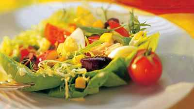 This recipe for salade nicoise has its name from a French phrase that means 'as prepared in Nice,' typifying the cuisine found in and around that French Riviera city.