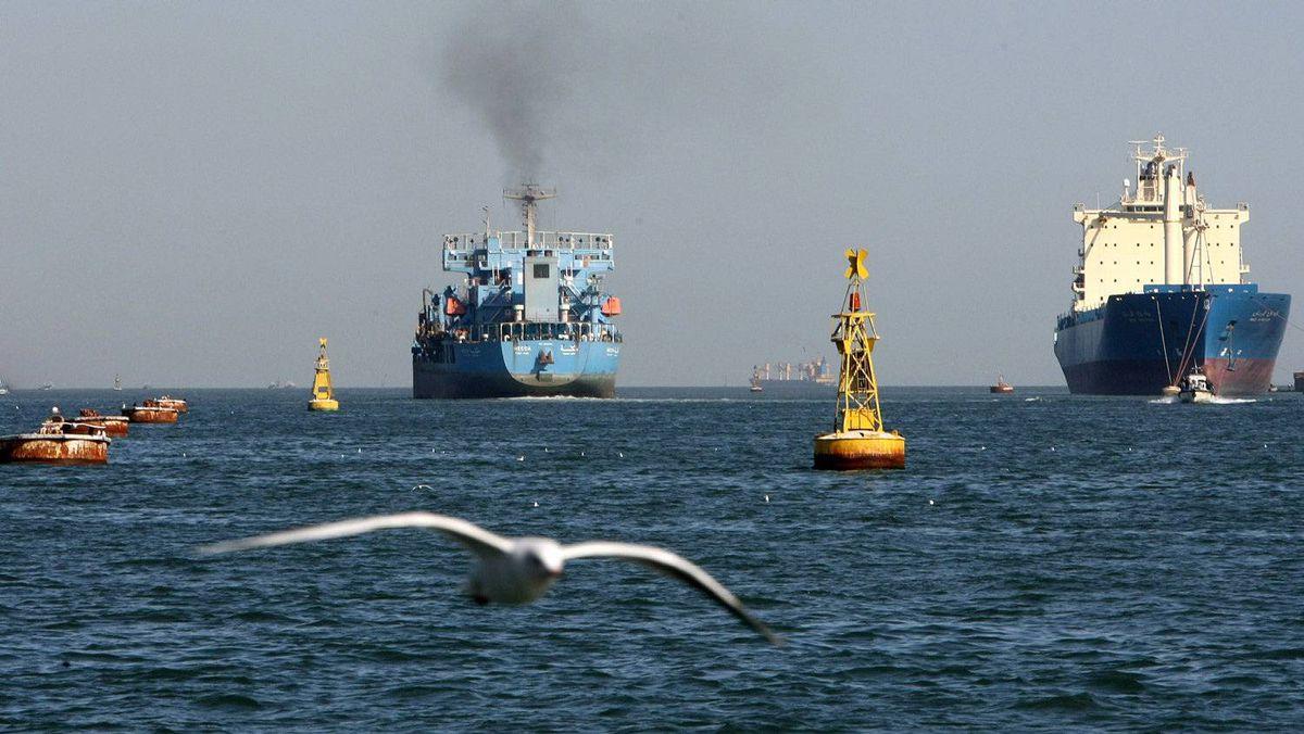Ships navigate the Suez Canal
