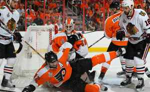 Simon Gagne #12 of the Philadelphia Flyers falls in front of the goal of teammate Michael Leighton #49 as Andrew Ladd #16 of the Chicago Blackhawks looks on in Game Four of the 2010 NHL Stanley Cup Final at Wachovia Center on June 4, 2010 in Philadelphia, Pennsylvania. (Photo by Jim McIsaac/Getty Images)