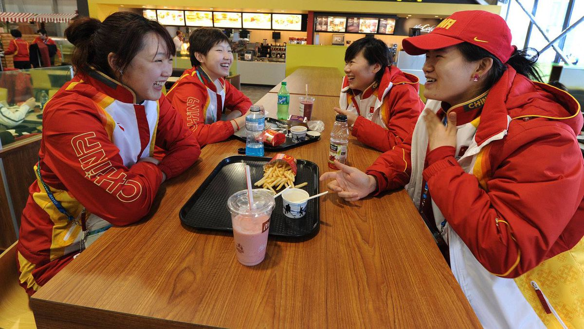 Chinese short-track speed skaters eat in the Winter Olympic athletes dining hall during a media tour of the Olympic Village in downtown Vancouver on February 9, 2010.
