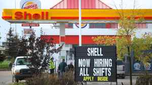 A service station in Fort McMurray, Alta., advertises for workers in this photo from August, 2010.