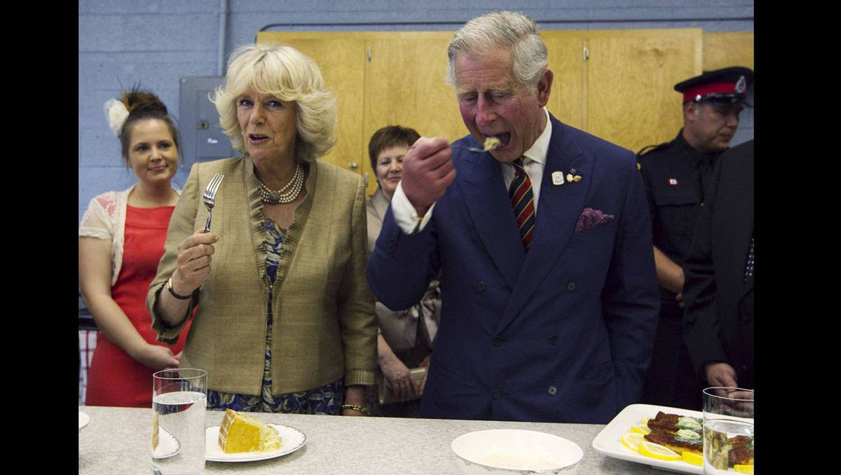 Prince Charles and Camilla, Duchess of Cornwall, taste maple cake during a visit to Hazen White-St. Francis school in Saint John, New Brunswick, May 21, 2012. The Prince of Wales and his wife are on a three-day royal tour of Canada as part of the events that mark the Queen's Diamond Jubilee.