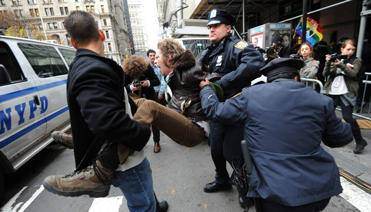 A man is arrested as demonstrators with 'Occupy Wall Street' mark the two month anniversary of the protest November 17, 2011 in New York.