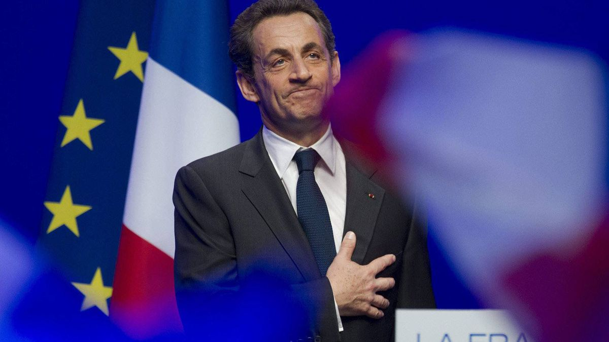 Outgoing French President Nicolas Sarkozy leaves after addressing supporters at his Union for a Popular Movement (UMP) party headquarters after the the preliminary results of the second round of the presidential elections were announced in Paris Sunday May 6, 2012.