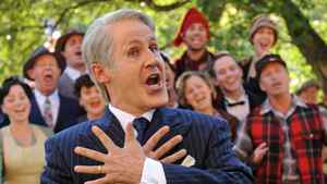 Rick Miller as Brian Mulroney, singing in front of the Baie Comeau chorus. Miller portrays the former prime minister in Mulroney: The Opera.