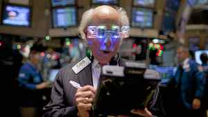 A trader works on the floor of the New York Stock Exchange in New York, U.S., on Friday, Dec. 30, 2011. Stocks that analysts praise at the start of the year often turn in lacklustre performances, a researcher has found.