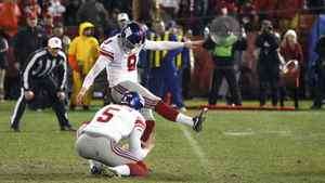 New York Giants kicker Lawrence Tynes kicks the winning field goal against the San Francisco 49ers in overtime on Jan. 22, 2012.