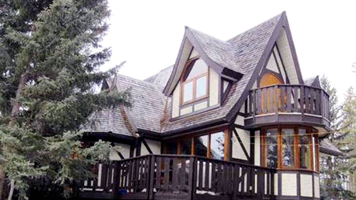 CANMORE: 705 Larch Pl., Canmore, AB T1W 1S2 Asking price: $799,000 This two-storey Bavarian style chalet, is nestled among the trees of Canmore, has four bedrooms and two bathrooms.