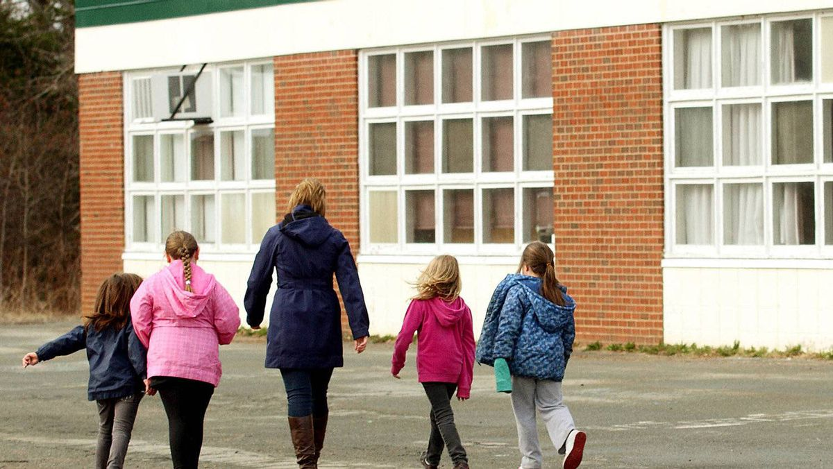 A teacher walks back to class with students after recess at the Newport Station District school in Newport Station, NS , April 5, 2012.