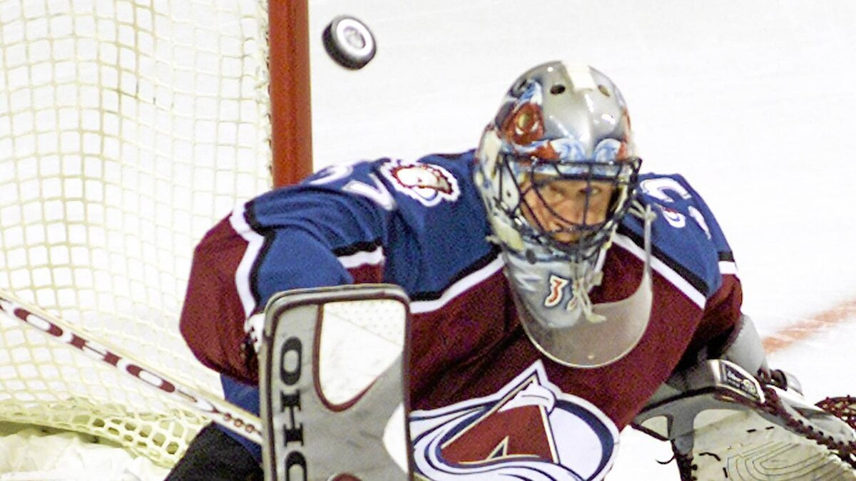 Colorado Avalanche Patrick Roy keeps his eyes on the puck as he makes a save against the Montreal Canadiens during first period NHL action in Montreal Tuesday Nov. 6, 2001.