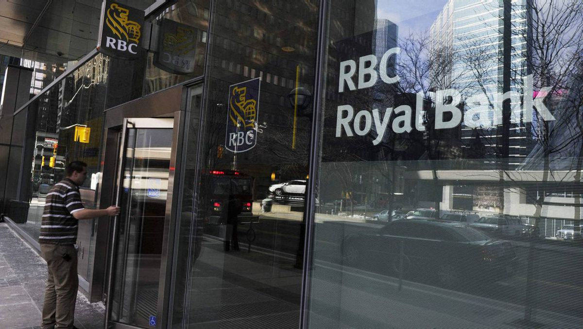 A man walks into a Royal Bank of Canada (RBC) in Toronto March 3, 2011.