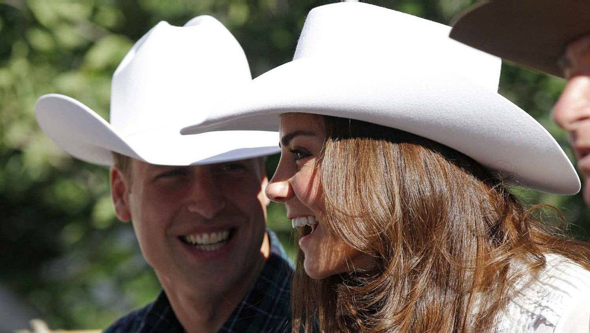 Prince William and his wife Catherine, Duchess of Cambridge, react during the official start of the Calgary Stampede parade in Calgary, Alberta July 8, 2011.