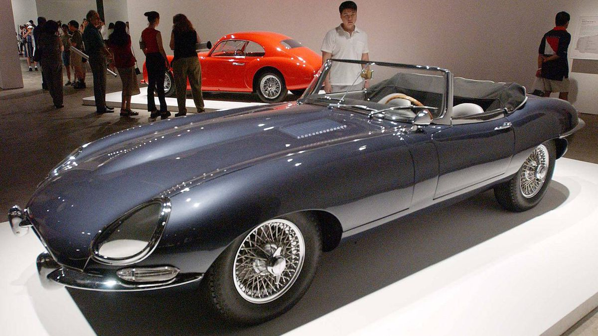 1963 Jaguar E-Type Roadster (front) and a 1946 Cisitalia 202 GT (rear) on display at the grand opening of the Museum of Modern Art (MoMA) in Queens, New York on June 29, 2002.