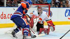 Taylor Hall #4 of the Edmonton Oilers just missed a deflection by Leland Irving #37 of the Calgary Flames during first period action on September 24, 2011 at the Rexall Place in Edmonton, Alberta, Canada. (Photo by Dale MacMillan/Getty Images)