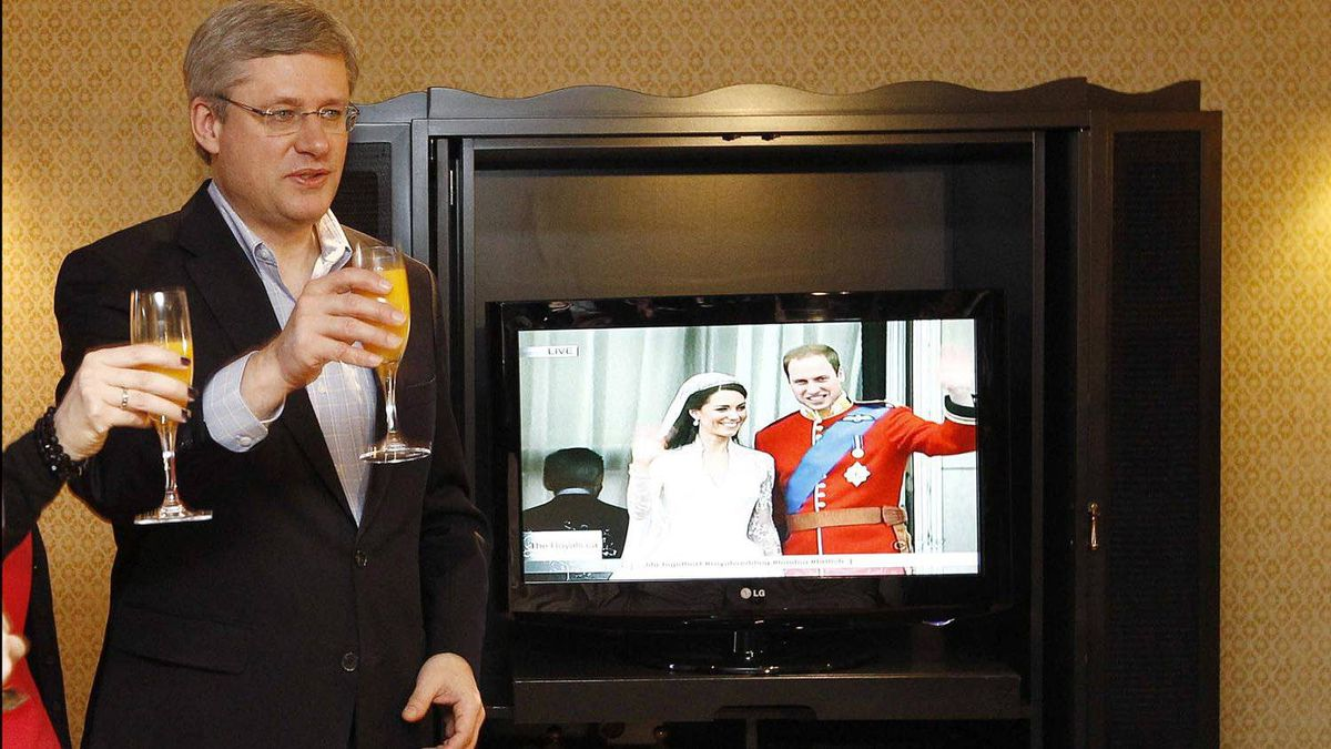 Conservative leader Stephen Harper offers a toast while watching the wedding of Prince William and Kate Middleton on television in Montreal April 29, 2011.