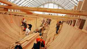 Workers line the hull of the schooner Bluenose II during the famed vessels refit in Lunenburg, NS, May 12, 2011.