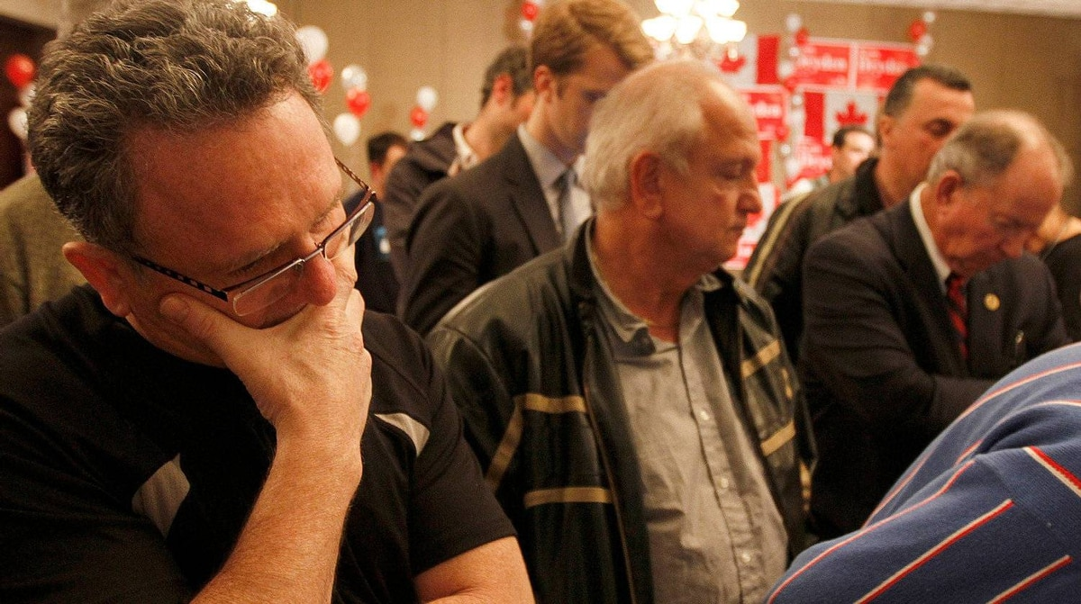 Supporters of York Centre Liberal candidate Ken Dryden watch the early results on tv at Montecarlo Casino Hotel on Chesswood Ave., Toronto May 02, 2011.