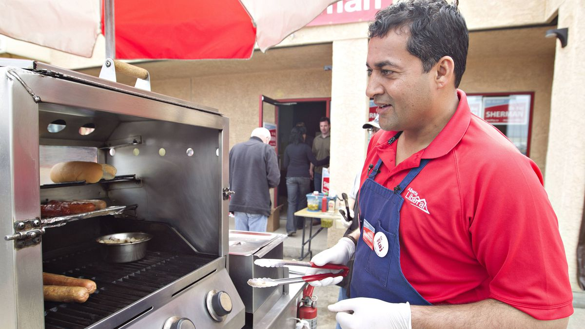 Alberta Liberal Leader Raj Sherman serves up hot dogs during the last day of campaigning at a barbecue for supporters in Edmonton, Sunday, April 22, 2012.